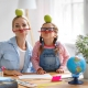 Mum and daughter have fun doing homework
