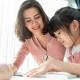 Happy mother and daughter homeschool in lockdown